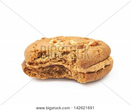Peanut butter homemade cookie with a bite taken of it, composition isolated over the white background