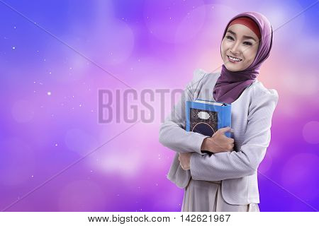 Beautiful Asian Woman Wearing Hijab Holding Koran
