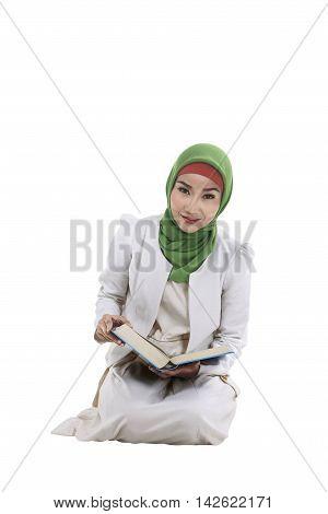 Young Asian Muslim Woman Holding Koran