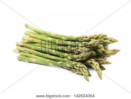 Pile of multiple cultivated green asparagus spears isolated over the white background