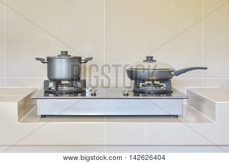 stainless stove and pots in modern kitchen