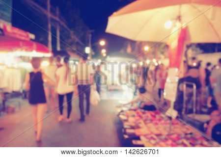 Vintage Photo Effect Of Blurred People Walking At Night Market Walking Street, Chiang Mai, Thailand