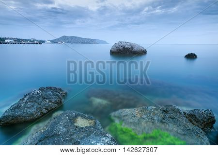 stones in water / bright evening photo summer Crimea