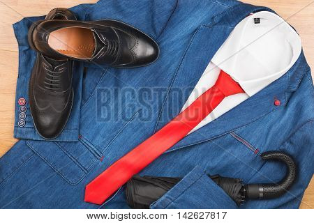 Denim jacket and red tie shoe and umbrella men's fashion with space for your text