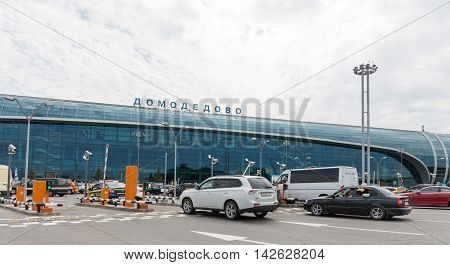 The Moscow region - 31 July 2016: Great Domodedovo passenger terminal of the airport and a lot of cars waiting for passengers 31 July 2016 Moscow region Russia