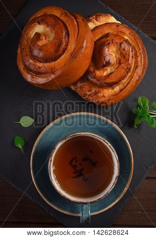 Top View Of Sweet Buns With Cup Of Tea