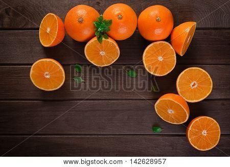 Orange Slices On Wooden Table