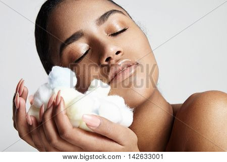 Woman With Closed Eyes Clasp To A Face Soft Cotton Balls