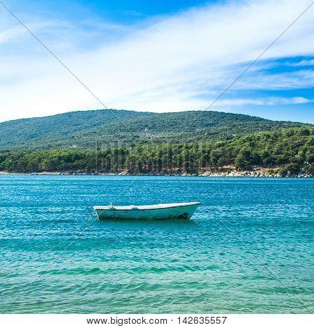 Boat in blue lagoon, Cres Island in Croatia, seascape, sunny summer day