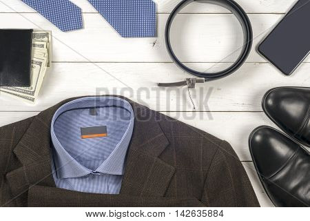 Set Of Men's Clothing And Shoes On Wooden Background. Men Access