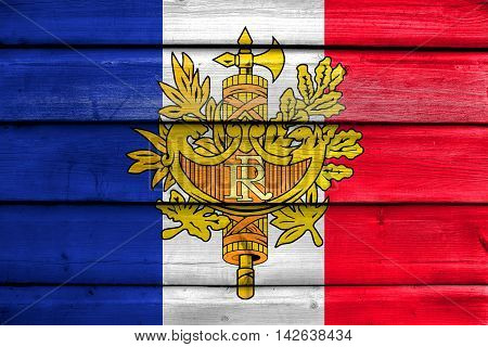 Flag Of France With National Emblem, Painted On Old Wood Plank Background
