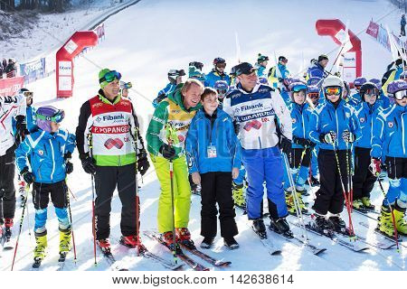Bansko, Bulgaria - December, 12, 2015: Open new ski season in Bansko, Bulgaria. Marc Girardelli, Markus Wasmeier, Petar Popangelov take photos with young skiers