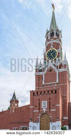 Moscow, Russia - July 07, 2016: Spasskaya Tower of the Kremlin wall with chimes and Borovitsky gates for entrance to the Kremlin