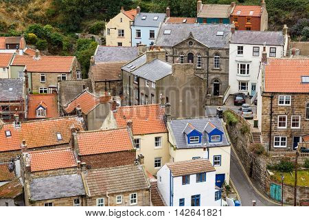 STAITHES ENGLAND - AUGUST 12: High view looking down onto rooftops of houses. In Staithes North Yorkshire England. On 12th August 2016.