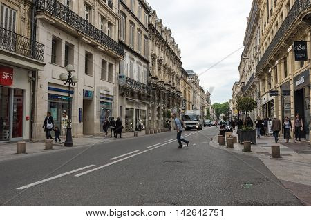 AVIGNON FRANCE - MAY 04 2015: Street scene in historical centre of Avignon. Avignon is a famous and very popular among tourists city in Provence in south of France