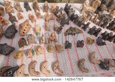 Slavgorod, Belarus - August 14: Fair Exhibition Of Handicrafts. Products Made Of Clay. Whistles Augu