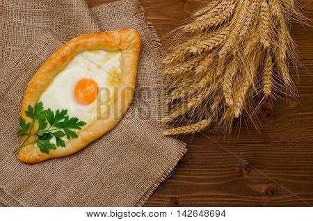 Flatbread with egg and cheese on sackcloth