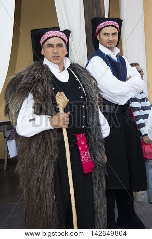 QUARTU S.E., ITALY - September 15, 2012: Parade of the Wine Festival 2012 - Sardinia - group of people in traditional Sardinian costume