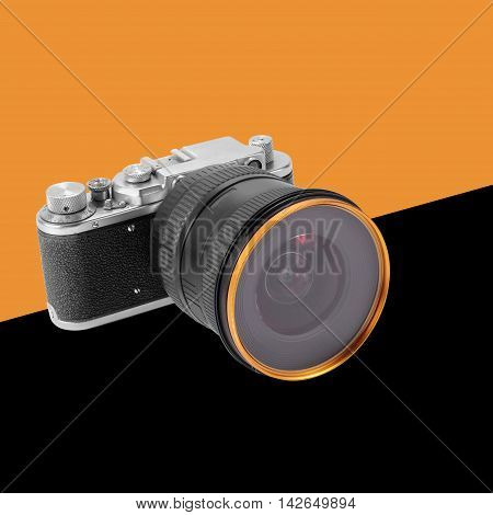 Old film camera on a orange and black background.