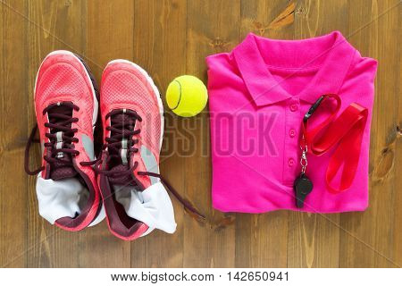 Set for sports referee, on wood background