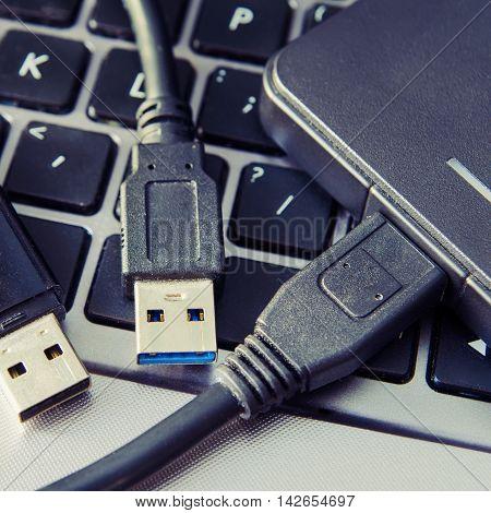 a part of laptop and usb closeup
