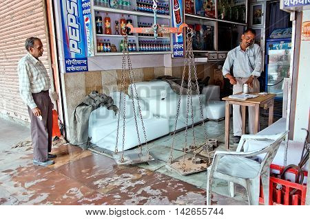 Jaipur India - Jule 29 2011: Indian vendor sell ice in a hot day