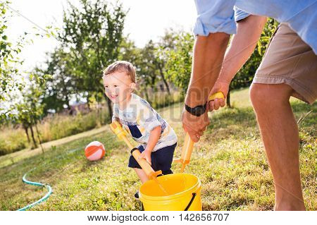 Little Boy With Father Playing With Water Guns, Splashing