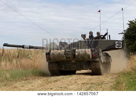 WESTERNHANGER, UK - JULY 22: A British army Challenger main battle tank gives a demonstration of firepower and maneuverability to the public at the W&P show on July 22, 2015 in Westernhanger