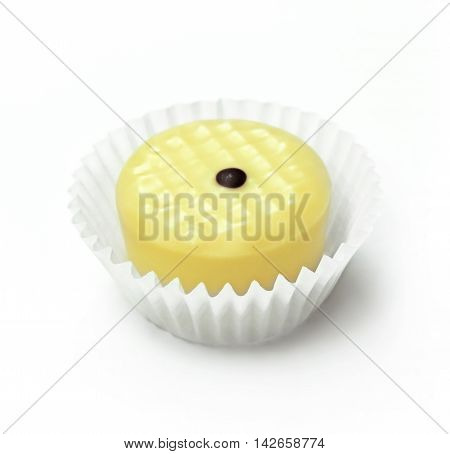 White chocolate truffle in paper, isolated on white.
