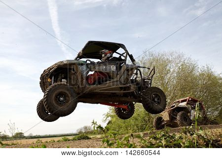 ARNCOTT, UK - MAY 4: An unnamed driver competing in the UK SXS RZR series lands on the top of the table-top jump before heading into a left handed bend on May 4, 2014 in Arncott