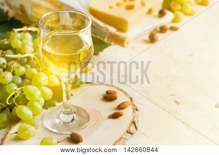 White wine in a glass on a white background tinted copy space.