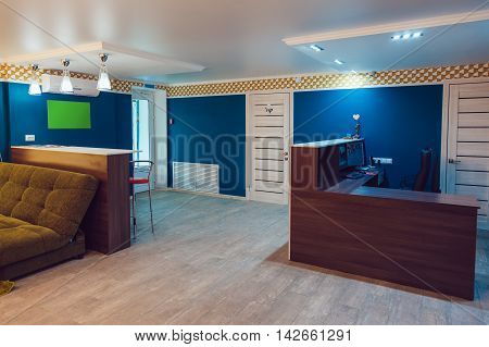 The Hostel interior - reception area. table, sofa, chair