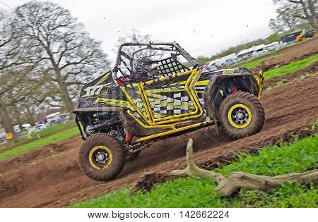 HYDE, UK - APRIL 6: G.Butler leads his Polaris SXS vehicle around a tight corner at speed during Round 1 of the 2014 UK SXS championship on April 6, 2014 in Hyde