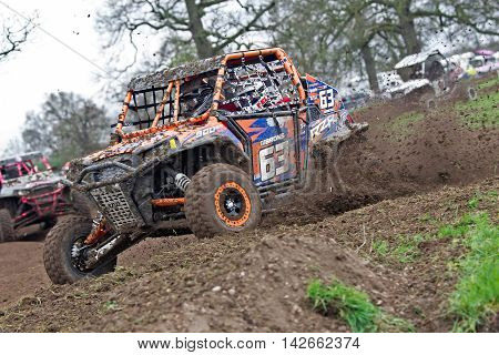 HYDE, UK - APRIL 6: Ian Gibbons leads his Polaris SXS vehicle around a tight corner at speed during Round 1 of the 2014 UK SXS championship on April 6, 2014 in Hyde