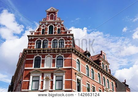 restored red brick historicist building in Hannover Germany