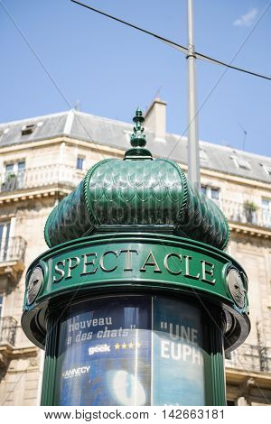 PARIS FRANCE - AUG 18 2014: Typical Paris Specatle - Concerts round advertising space in the center of Paris on a sunny day