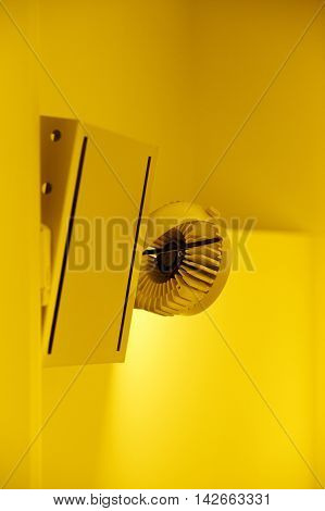Professional modern lighting - illuminated ceiling LED lamps in modern grunge interior difussing yellow light