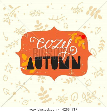 Cozy Autumn hand lettering and hand drawn fall elements leaves berries brunches and twigs.
