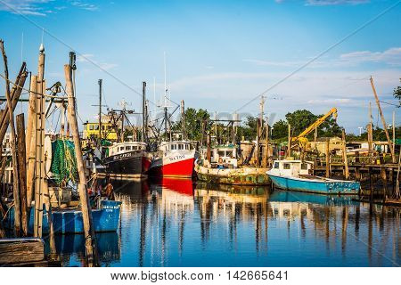 MIDDLETOWN NEW JERSEY- AUGUST 6 - Commercial fishing boats on Shoal Harbor on August 6 2016 in Middletown NJ.
