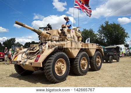 POTTEN END, UK - JULY 27: A vintage ex British army Saladin armoured car is displayed for public viewing in the main arena at the Dacorum Steam fair on July 27, 2014 in Potten End
