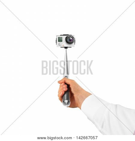 Hand holding action camera isolated, take selfie. Monopod hold in arm. Active cam, making self portrait. Selfi stick holder.