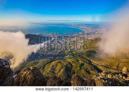 National Park Table Mountain, Cape Town. The mountain is covered with clouds. View of the Atlantic Ocean into the sunset
