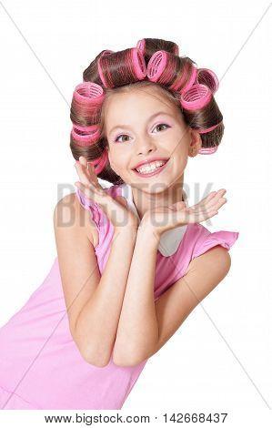 portrait of happy Little pretty girl   in hair curlers in studio