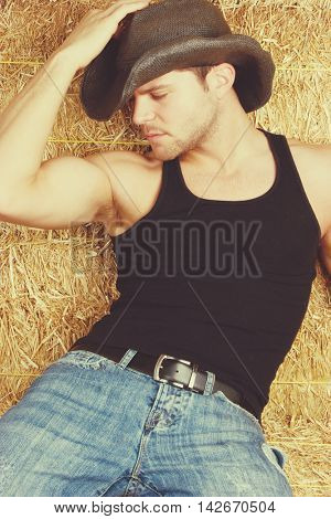 Sexy man wearing cowboy hat