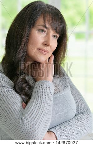 Portrait of a thoughtful senior woman at home