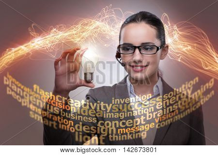 Young call center operator with bulb in idea concept