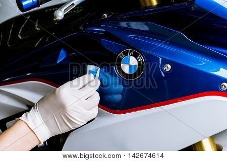 BANGKOK, THAILAND - AUGUST 11, 2016 : Closeup of hand polishing BMW S1000RR  2015 model paint. BMW S1000RR is sport bike manufactured by BMW Motorrad