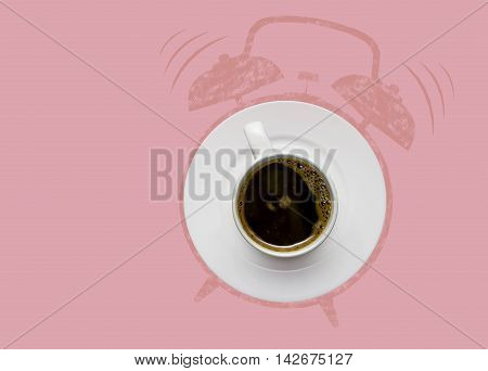 Creative concept photo of a coffee cup on a plate and illustrated alarm clock on pink background.