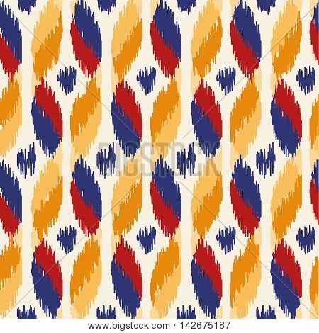 Seamless geometric pattern, based on ikat fabric style. Vector illustration. Oriental rug pattern, in yellow, orange and red. Wave pattern.