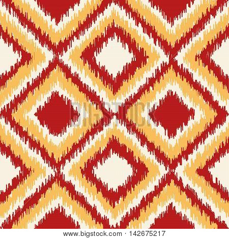 Seamless geometric pattern, based on ikat fabric style. Vector illustration. Oriental rug pattern, in yellow, orange and red. Checkered geometric pattern for comforter. Diamond shapes seamless.